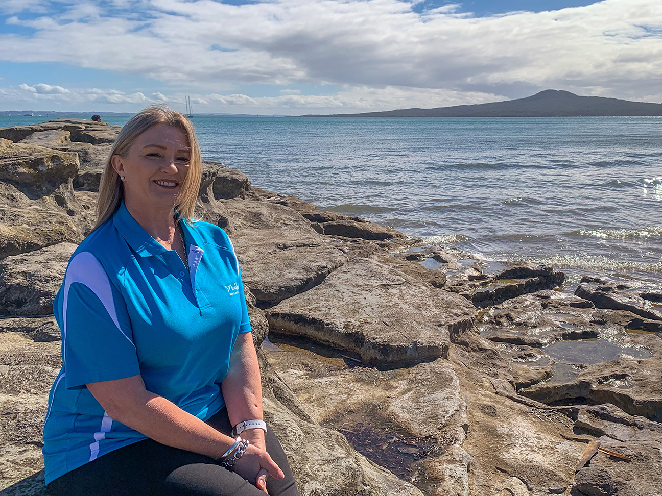 MoaTours Kiwi Guide Dianne on the beach with Rangitoto in the background