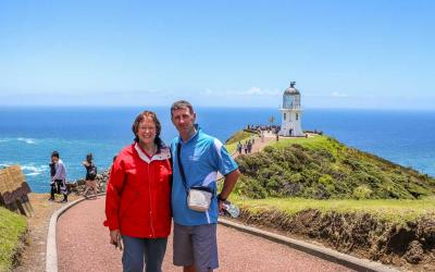 MoaTours Kiwi guide and guest at the Cape Reinga Lighthouse