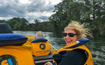 Guest enjoying the jetboat ride on the Waiau River in Fiordland