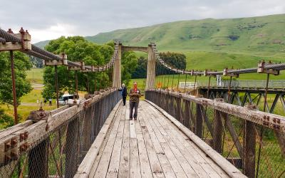 Walking on the Springvale Suspension Bridge on the Gentle Annie Road, Central North Island