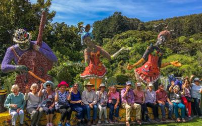 MoaTours group photo amongst the sculptures at Giants Gate garden in Akaroa