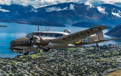 Vintage plane flying over Lake Wanaka - Warbirds with MoaTours