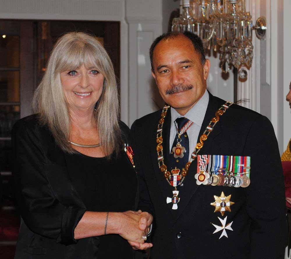 Dame Suzie Moncrieff receiving her Dame Companion from the Governor General