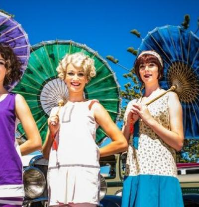Ladies in Colourful Art Deco Dress and Vintage Cars at the Hawkes Bay Art Deco Festival
