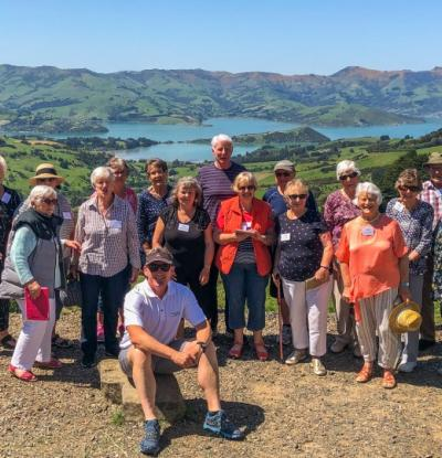 MoaTours guide Andre and Garden tour group on Banks Peninsula