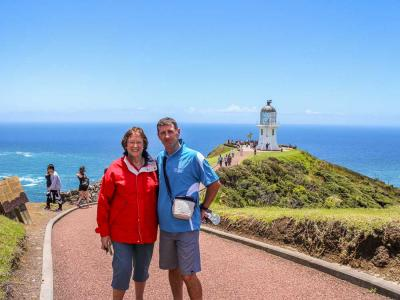MoaTours Guest and Kiwi Guide at the Cape Reinga Lighthouse