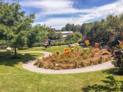 Visitors walking through Lynden Overs Glass Sculpture Garden in Taupo