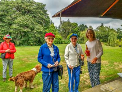 Colourful visitors, host and dog at Akaunui Gardens in Canterbury