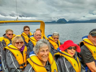 MoaTours group enjoying a jetboat ride on the Waiau River, Fiordland