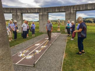 Guests enjoying a guided tour at Stonehenge Aotearoa in Wairarapa